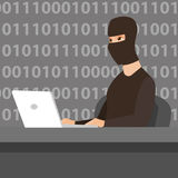 Hacker using laptop to steal information. Stock Image