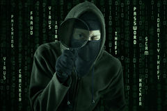 Hacker using magnifying glass Royalty Free Stock Photo