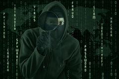 Hacker using magnifying glass for spying royalty free stock image
