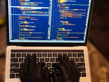Hacker using malicious code or virus program for anonymous cyber attack. Cybercrime, hacking and technology concept. Web breaching. Hacker hands in gloves royalty free stock photos