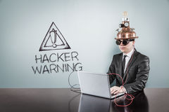 Hacker warning text with vintage businessman using laptop Stock Photo