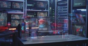 Hacker watching holographic display screens