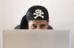 Hacker watching and smiling Royalty Free Stock Images