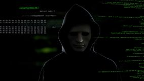 Hacker in white mask stealing important information from server terrorist attack. Stock photo stock images