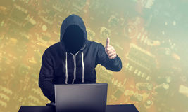 Hacker at work. Portrait of a hacker at work. Internet security concept Stock Image
