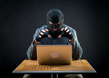 Hacker at work. Hacker is ready to start hacking laptop Stock Photography