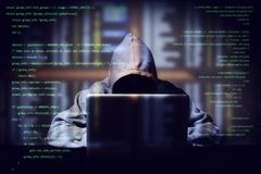 Hacker working on a computer code with laptop, double exposure with digital interface around at background. internet crime royalty free stock images