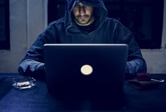 Hacker working on computer cyber crime stock image