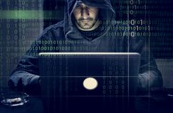 Hacker working on computer cyber crime Royalty Free Stock Images