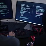 Hacker working on computer cyber crime Royalty Free Stock Photography