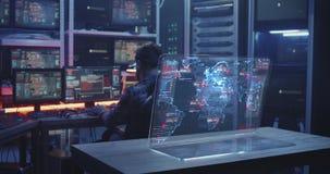 Hacker working with futuristic display screen