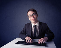 Hacker working with keyboard on blue background Royalty Free Stock Photography