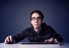 Hacker working with keyboard on blue background Royalty Free Stock Photos