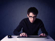 Hacker working with keyboard on blue background Stock Image