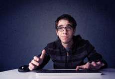 Hacker working with keyboard on blue background Royalty Free Stock Images