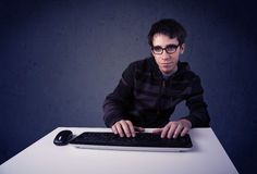 Hacker working with keyboard on blue background Stock Photos