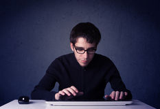 Hacker working with keyboard on blue background Royalty Free Stock Photo