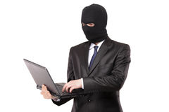 A hacker working on a laptop Royalty Free Stock Photography