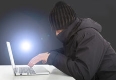 Hacker working  with a laptop computer in the darkness Royalty Free Stock Image