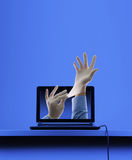 Hackers Attack. Laptop (Netbook) with Hackers Hands Out of It stock images