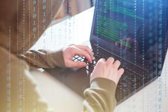 Hackers programmer look on screen and writes the program code hack information royalty free illustration