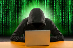 Hackers programmer using computer laptop for hack. Information and data from user account Royalty Free Stock Photos