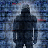 Hackey en silhouette et codes binaires photo stock