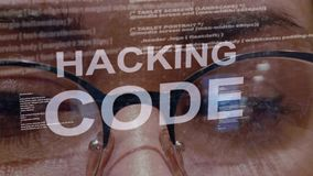 Hacking code text on background of female developer. Hacking code text on the background of female software developer. Eyes of woman with glasses are looking at stock footage
