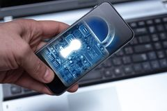 Hacking mobile devices by hackers. Data protection in the cloud stock photo