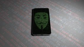 Hacking personal information on the phone. Guy Fawkes mask.