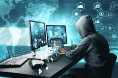Hacking and phishing concept. Side view of hacker using computer with digital interface while sitting at desk of blurry interior. Hacking and phishing concept royalty free stock photos