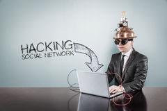 Hacking social network text with vintage businessman using laptop Stock Photos