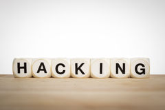 Hacking spelled out with toy dice Stock Photo