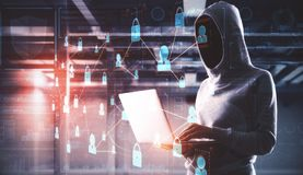 Hacking and theft concept. Hacker using laptop with abstract business interface in blurry office interior. Double exposure royalty free stock images