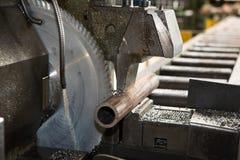 Hacksaw. Sawing a metal pipe Royalty Free Stock Images