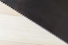 Hacksaw blade and wood plank texture Stock Photo