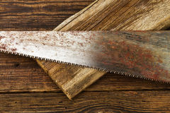 Hacksaw and board Stock Photo