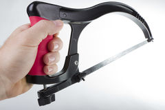 Hacksaw in hand Royalty Free Stock Photo