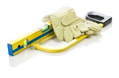 Hacksaw, level and gloves Royalty Free Stock Image