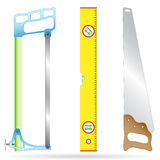Hacksaw, ruler and wood-working saw Royalty Free Stock Photography