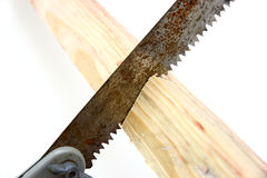 Hacksaw in sawed yellow wooden. Board on white background Stock Images