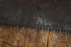 Hacksaw on the table. A hacksaw on the old table background texture lies Royalty Free Stock Images