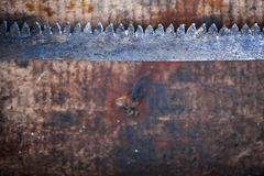 Hacksaw on wooden plank Stock Photos