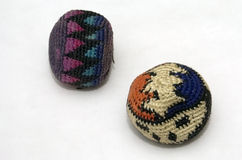 Hacky. Two well-worn hacky-sack footbags against a white background Royalty Free Stock Images