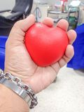 We have to squeeze the ball heart-shaped to give blood in our body flows into the bag of blood donation. stock photo
