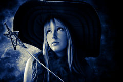 Hada hermosa con la varita mágica y el sombrero grande Imagen de archivo libre de regalías