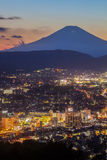 Hadano city night scape view with mountain Fuji at sunset time Stock Images