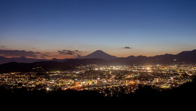 Hadano city night scape view with mountain Fuji Stock Photo