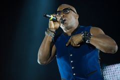 Haddaway performing live during a disco party. CLUJ NAPOCA, ROMANIA - NOVEMBER 19, 2017: One of the 90s biggest disco musicians, Haddaway performing live on the Stock Photo