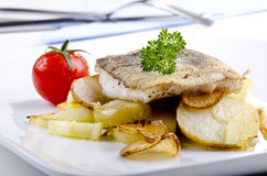 Haddock fillet on a plate Royalty Free Stock Photos